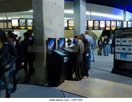 paris-france-people-buying-tickets-for-french-multiplex-ugc-cinema-c4fygg.jpg